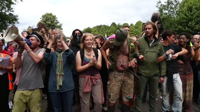 mid panning shot, protestors clapping and shouting. protesters gather outside a drill site operated by cuadrilla resources ltd on august 19, 2013 in... - west sussex stock videos & royalty-free footage