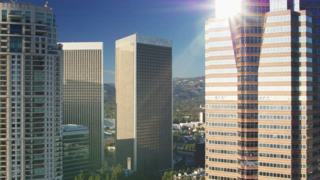 mid point of century city office towers - drone shot - century city stock videos & royalty-free footage