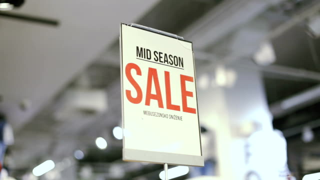 mid season sale sign in store