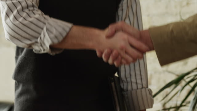 cu mid section of two men shaking hands / provo,utah,usa - provo stock videos & royalty-free footage