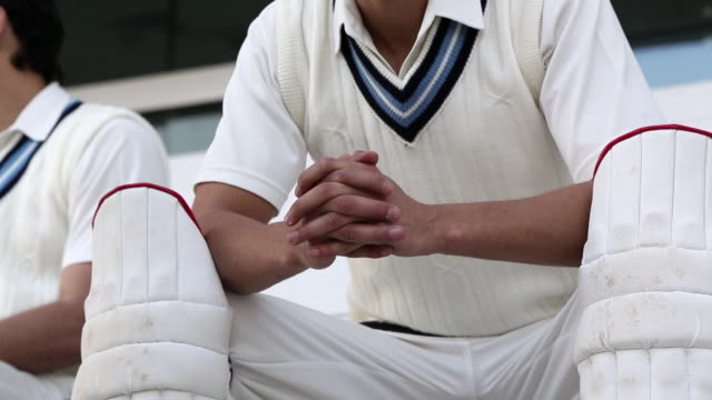 mid section view of cricket players sitting in the stadium, delhi, india - cricket stock videos & royalty-free footage