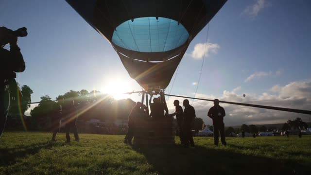 Mid Shot A balloon is inflated at the Bristol International Balloon Fiesta at the Ashton Court estate on August 9 2013 in Bristol England Due to the...