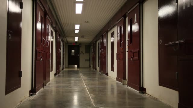 mid shot, a hallway is seen at the u.s. military prison for 'enemy combatants' on june 25, 2013 in guantanamo bay, cuba. president barack obama has... - guantanamo bay stock videos & royalty-free footage