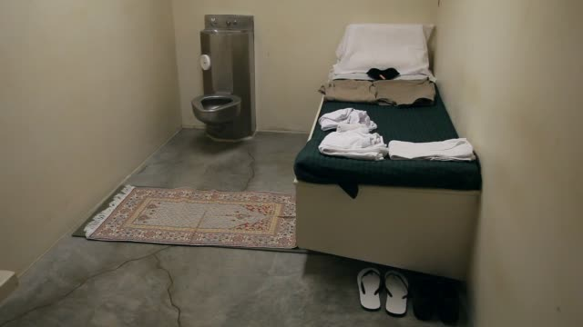 mid shot, a prisoner's belongings are part of a static display setup for visitors in a prison cell at camp vi where prisoners are housed in the... - guantanamo bay stock videos & royalty-free footage