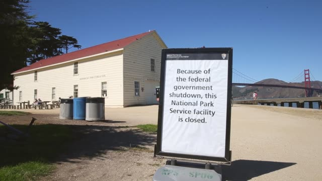 "mid shot, a sign is posted in front of the warming hut café and store at crissy field reading:""because of the federal government shutdown, this... - government shutdown stock videos & royalty-free footage"