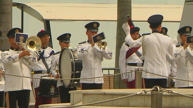 mid shot army band hong kong china - banda che marcia video stock e b–roll