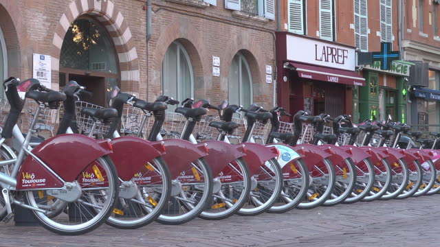"""mid shot - bicycle station """"vélo toulouse"""" - bicycle parking station stock videos and b-roll footage"""