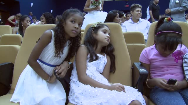 Mid Shot children are waiting for the ceremony to start at what was billed as the world's largest communal gay wedding on December 8 2013 in Rio de...