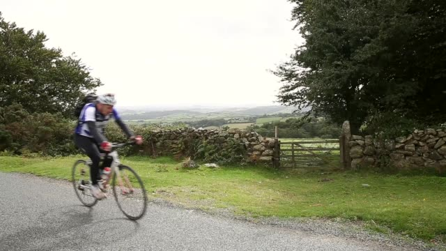 mid shot cyclists following the tour ride uphill stage six of the tour of britain made history this year as it was the first stage to host a summit... - tour of britain stock videos & royalty-free footage