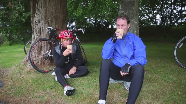 mid shot cyclists following the tour take a tea break stage six of the tour of britain made history this year as it was the first stage to host a... - tour of britain stock videos & royalty-free footage