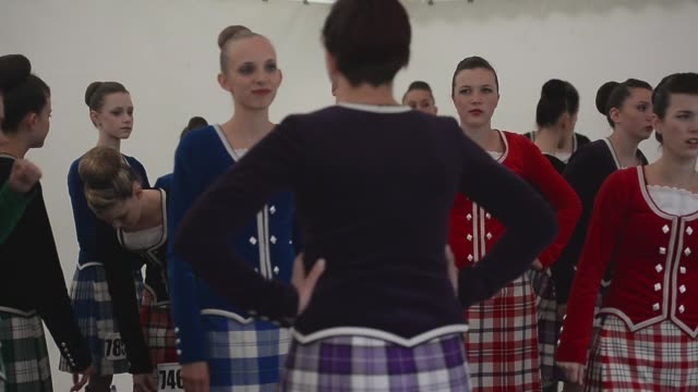 mid shot dancers warm up for the dance competition at the cowal highland gathering people attend the cowal highland gathering on august 30 2013 in... - highland games stock videos & royalty-free footage