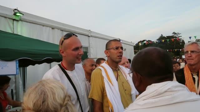 vídeos y material grabado en eventos de stock de mid shot devotees sing the hare krishna mantra during the janmashtami hindu festival at bhaktivedanta manor on august 28 2013 in watford england up... - krishna