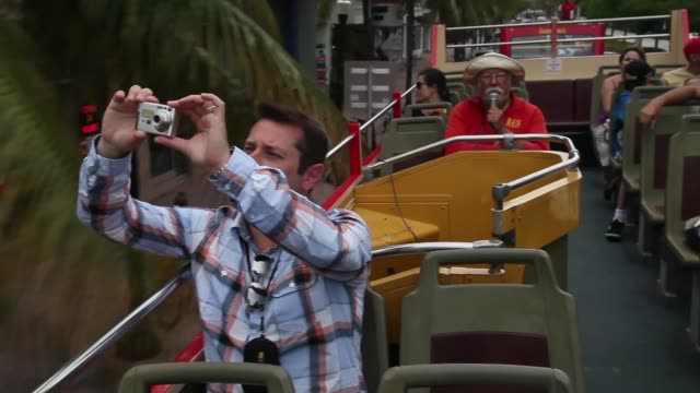 Mid Shot Dmitry Shtykhno on vacation from Moscow Russia enjoys the sights from onboard a Big Bus Tour double decker bus during a sightseeing trip to...