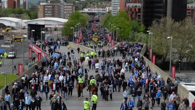 mid shot, fans arriving at wembley stadium. manchester city v wigan athletic - fa cup final at wembley stadium on may 11, 2013 in london, england - semifinal round stock videos & royalty-free footage