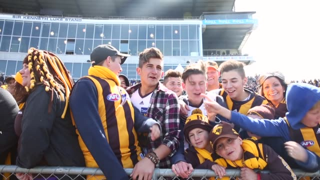 Mid Shot fans sing as they watch the Hawthorn Hawks final training session prior to the 2013 AFL Grand Final at Waverley Park