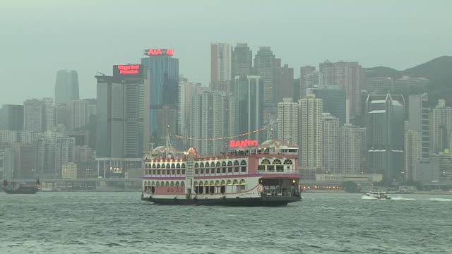mid shot ferry in aberdeen harbour hong kong kwangtung china - aberdeen hong kong stock videos & royalty-free footage