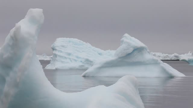Mid Shot Icebergs are seen in the water off the coast of Ilulissat Greenland As the sea levels around the globe rise researchers affiliated with the...