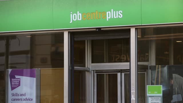 mid shot, job centre plus entrance. people walk past a job centre plus on brixton road, brixton, london on the 30th of september 2013. - job centre stock videos & royalty-free footage