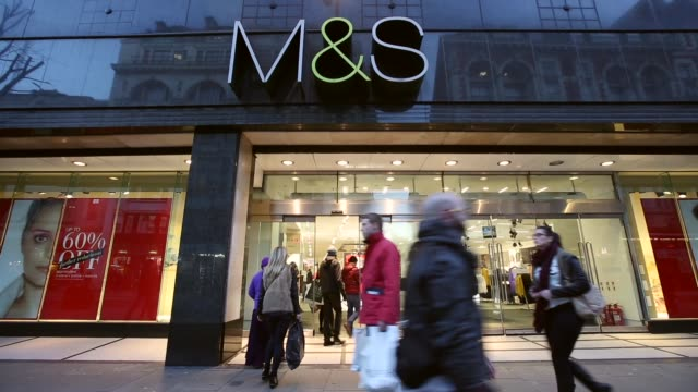 vídeos de stock e filmes b-roll de mid shot marks and spencer shop front on oxford street london members of the public walk past a branch of marks spencer on oxford street on january 7... - marks and spencer