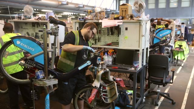 mid shot, mechanics repair damaged barclays cycle hire bikes in the mechanical workshop of the cycle hire's penton street depot on september 5, 2013... - new hire stock videos & royalty-free footage