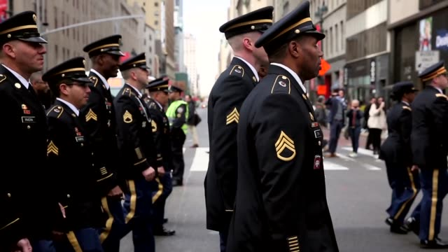 mid shot military personnel and civilians matching in the commemorative parade the parade included members of all four branches of service as well as... - armistice day stock videos and b-roll footage