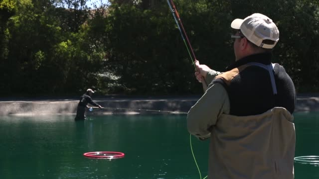 mid shot of a angler practising casting. the golden gate angling & casting club located in the heart of beautiful golden gate park in san francisco... - fishing rod stock videos & royalty-free footage
