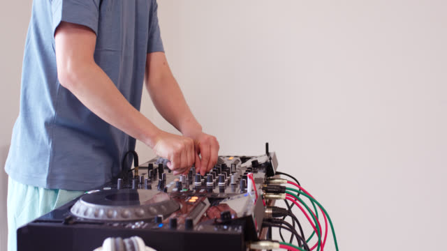 mid shot of a dj practicing at home - deck stock videos & royalty-free footage