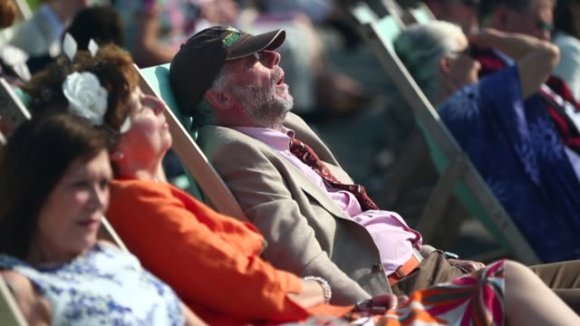 mid shot of a man sleeping in a chair at the henley royal regatta - rowing stock videos & royalty-free footage