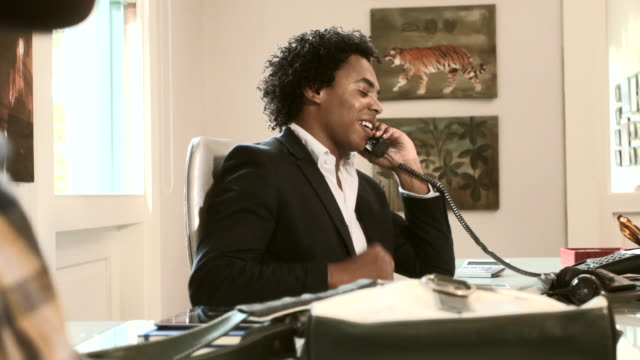 mid shot of a man speaking on a telephone - formal businesswear stock videos & royalty-free footage