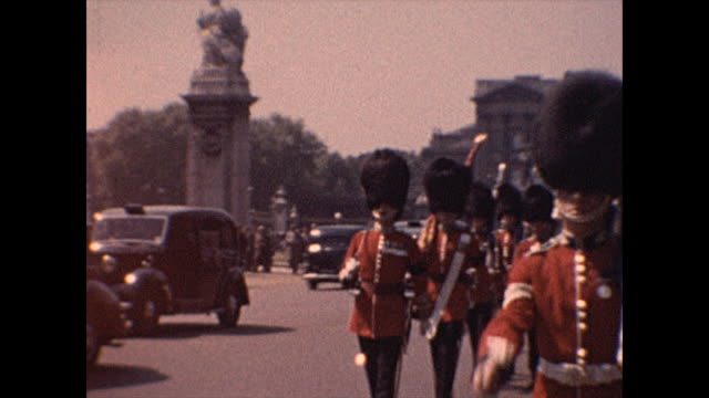 mid shot of a parade of british soldiers on horseback in 1952 london. british guard in red marching in unison. men march playing bagpipes. from the... - famous place stock videos & royalty-free footage
