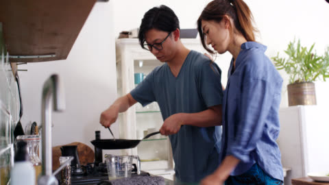 mid shot of a young couple cooking breakfast together - japanese food stock videos & royalty-free footage