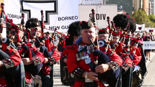 mid shot of army band marching and playing on scottish blow pipes australians commemorate anzac day on april 25 2013 in various cities australia mid... - anzac day stock videos & royalty-free footage