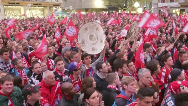 Mid shot of Bayern Muenchen fans celebrating the German championship title at Marienplatz on May 11 2013 in Munich Germany FC Bayern Muenchen German...