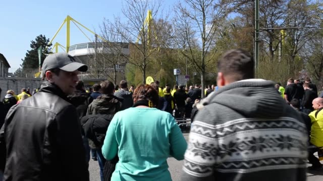 Mid shot of Borussia fans arriving at the stadium with stadium in background Signal Iduna Park General View at Signal Iduna Park on April 20 2013 in...