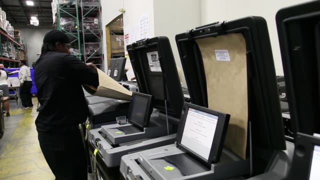 mid shot of election official checking voting machine for accuracy no sound miamidade county elections department tests voting equipment ahead of mid... - miami dade county bildbanksvideor och videomaterial från bakom kulisserna