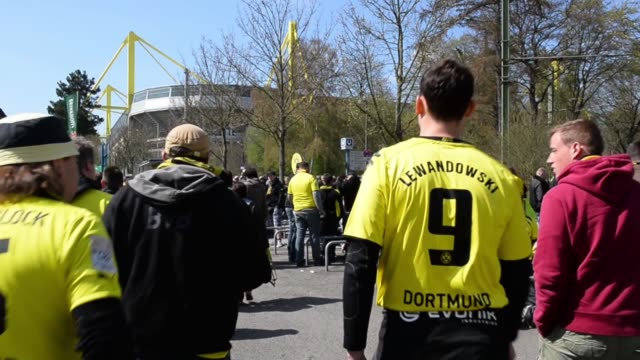 mid shot of fans arriving at the stadium signal iduna park general view at signal iduna park on april 20 2013 in dortmund federal republic of germany - borussia dortmund stock videos and b-roll footage