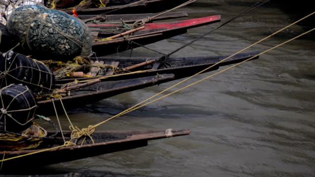mid shot of fishing boats and flowing water. - kolkata stock videos & royalty-free footage