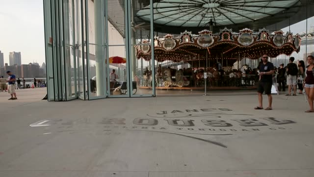 Mid Shot of 'Jane's Carousel' signage Janes Carousel is a classic 3row machine with 48 exquisitely carved horses and two superb chariots It was...