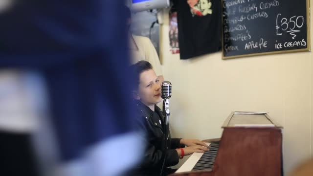 mid shot of lewis jordan brown performing a rock n' roll song at the piano. fans of rock and roll, rockabilly, rockin' blues and americana gather at... - holiday camp stock videos & royalty-free footage