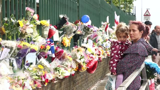 mid shot of members of the community lay flowers close to the scene where drummer lee rigby of the 2nd battalion the royal regiment of fusiliers was... - brutal killing stock videos & royalty-free footage
