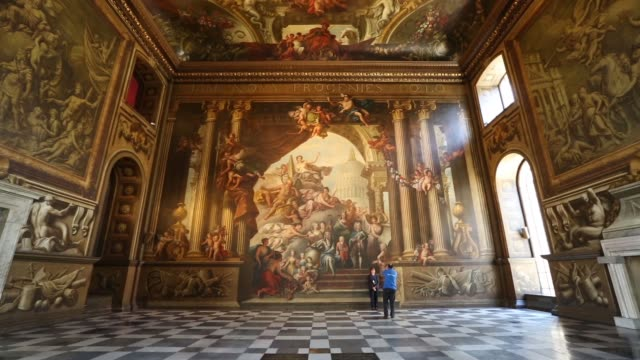 mid shot of painted wall guests admire the west wall of the the old royal naval college's painted hall following its first restoration in 50 years on... - royal navy college greenwich stock videos & royalty-free footage