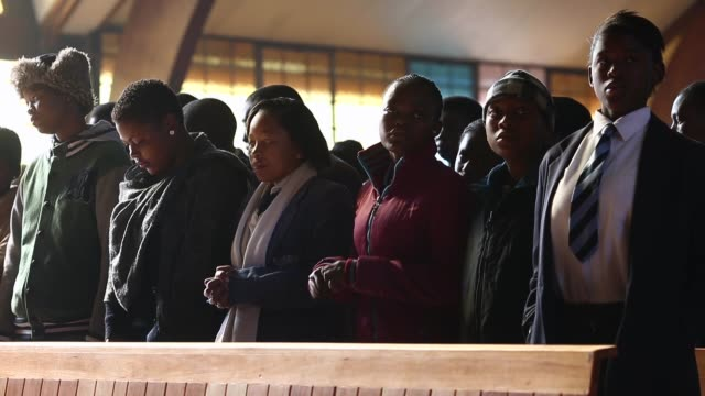 mid shot of people praying at church the congregation prays during a sunday service at regina mundi church in soweto on june 16 2013 in johannesburg... - afrikaans stock videos & royalty-free footage