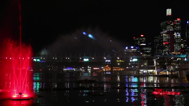 Mid shot of The Aquatique fountain and light show at Darling Harbour Vivid Sydney Opening Night on May 24 2013 in Sydney Australia