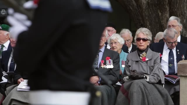 mid shot of veterans with families watching the commemoration. mid shot of veterans with families watching the on april 25, 2013 in various cities,... - anzac day stock videos & royalty-free footage