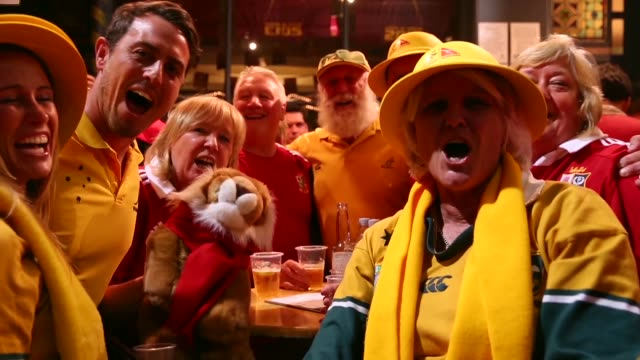 mid shot of wallabies fans singing ahead of the match. - singing stock videos & royalty-free footage