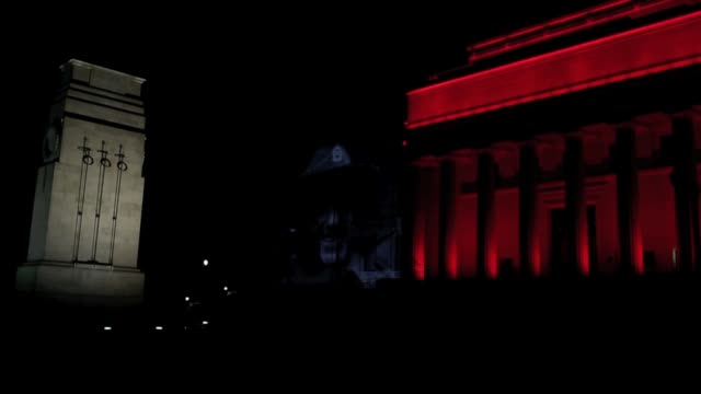 mid shot of war archive film projected onto the auckland museum and spectators watching no sound new zealand celebrates anzac day on april 25 2013 in... - anzac day stock videos & royalty-free footage