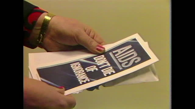 mid shot of woman opening an aids pamphlet sent by the uk government as a part of the ''aids: don't die of ignorance'' campaign; 1987. - correspondence stock videos & royalty-free footage