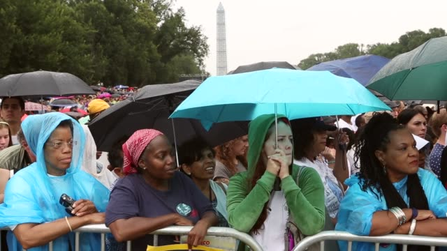 mid shot people listen to us president barack obama address the event 'let freedom ring commemoration and call to action' honoring the 50th... - i have a dream 1963 speech stock videos & royalty-free footage