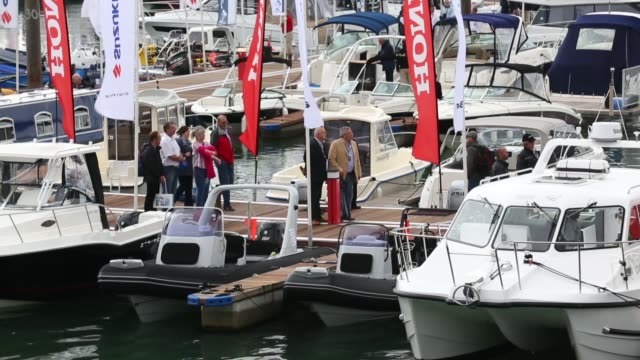 mid shot people look at the various types of boats for sale on the opening day of the annual psp southampton boat show on september 13 2013 in... - world water day stock videos and b-roll footage