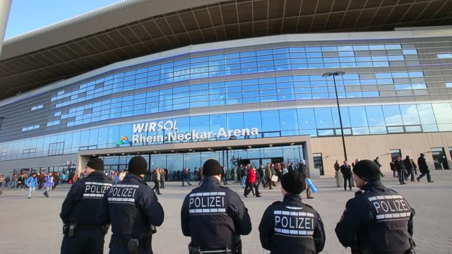mid shot, police officers in front of stadium. general views of the wirsol rhein neckar arena prior to the bundesliga match between 1899 hoffenheim... - 1899 stock videos & royalty-free footage